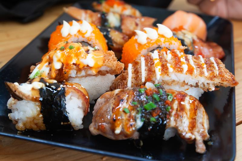Fresh and delicious sushi rolls on plate. Close up stock photography