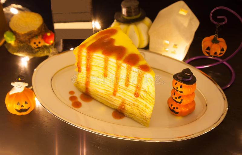 Fresh delicious sweet food dessert Strawberry Crepe Cake decorated with festive Halloween theme background. Sweets, treats, snack, stock image