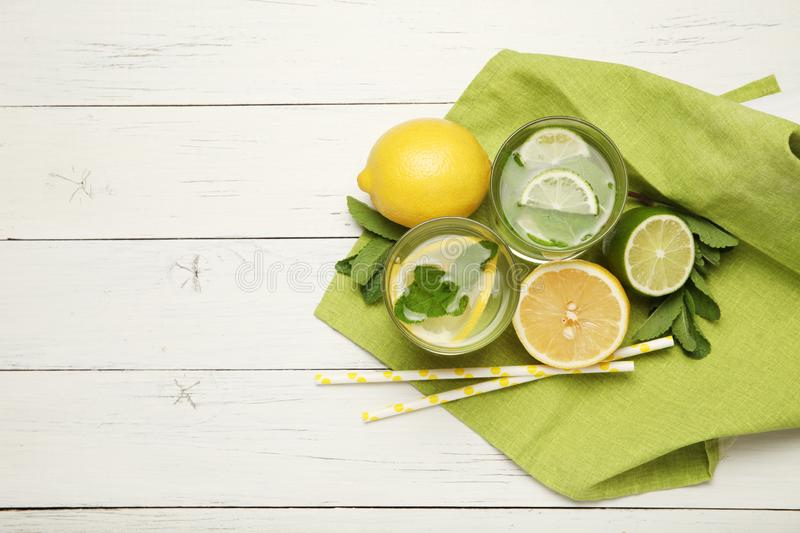 Fresh detox lemon water, healthy drink. Summer citrus lemonade.  royalty free stock photo