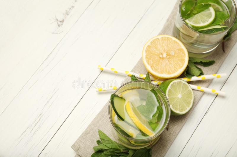 Fresh detox lemon water, healthy drink. Summer citrus lemonade.  stock photos