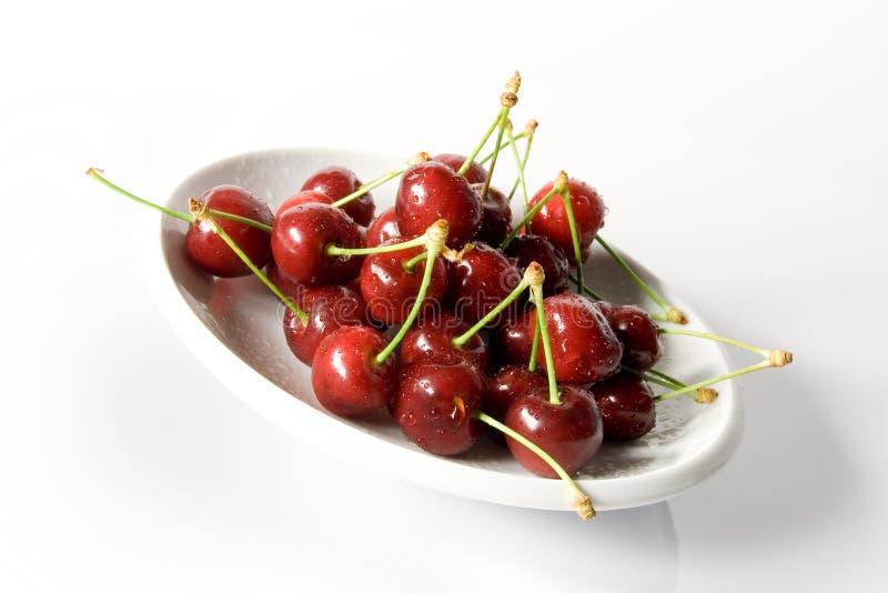 Fresh Dewy Cherry. On saucer stock photos