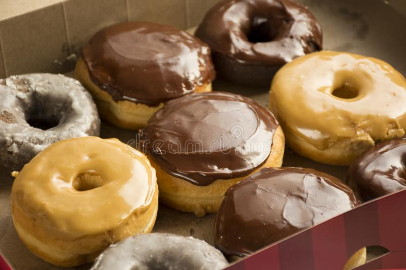 Fresh Donuts in a box. Donuts royalty free stock photo
