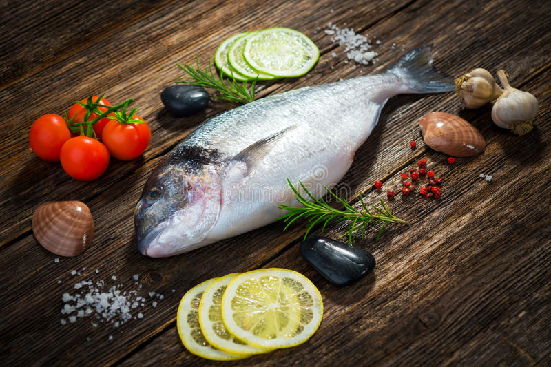 Fresh dorade. With aromatic ingredients royalty free stock images