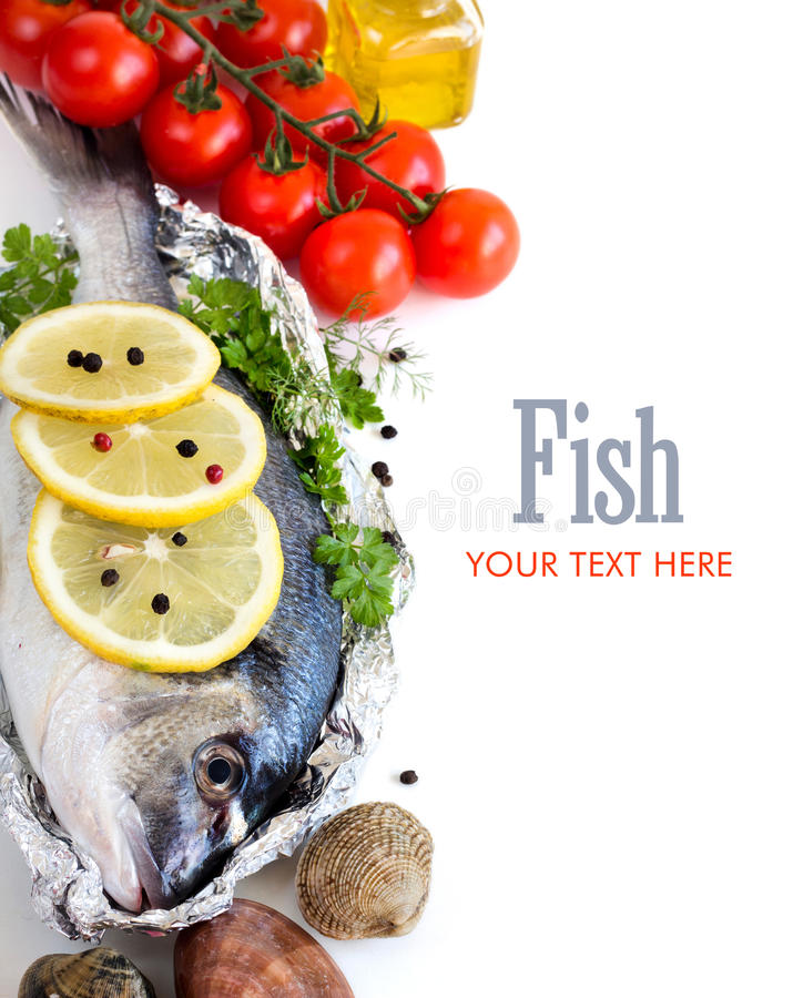 Fresh dorado fish, seafood and vegetables royalty free stock image