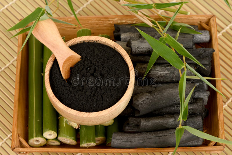 Fresh and dried bamboo and Bamboo charcoal powder. royalty free stock photo