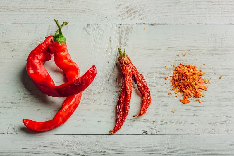Fresh, dried and crushed red chili pepper stock photos