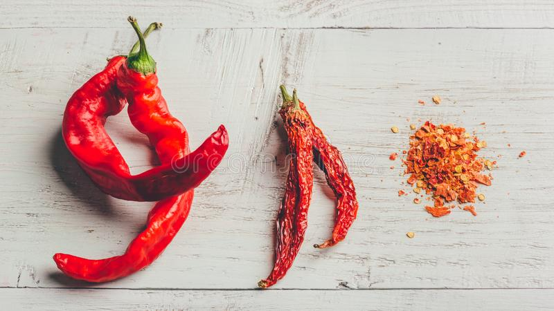 Fresh, dried and crushed red chili pepper stock photography