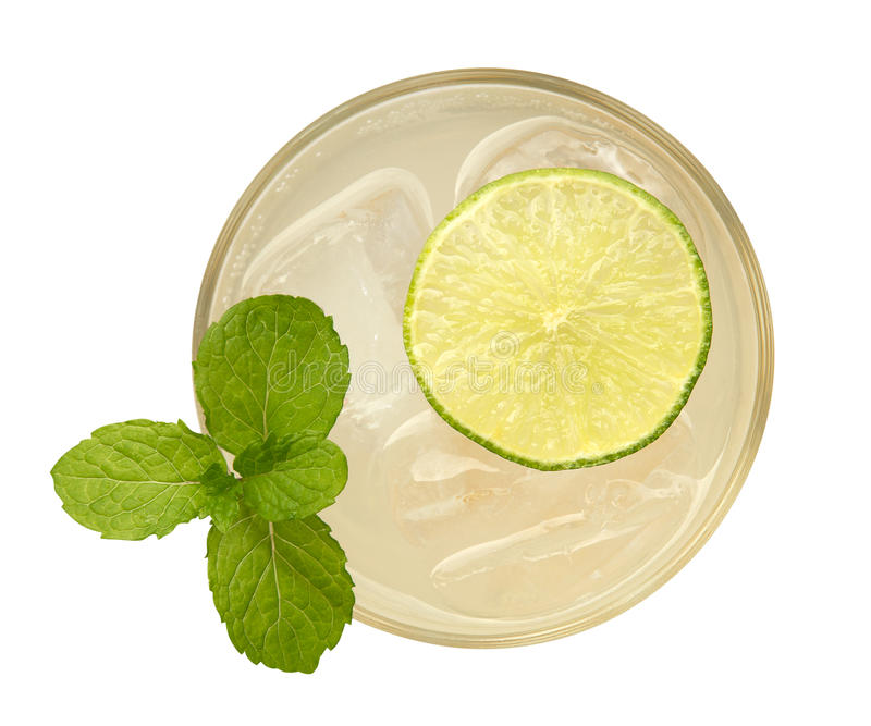 Fresh drink cocktail with mint and lime top view isolated on white background royalty free stock photography