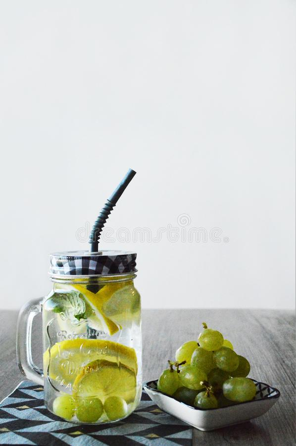 Fresh drink and grapes stock photography