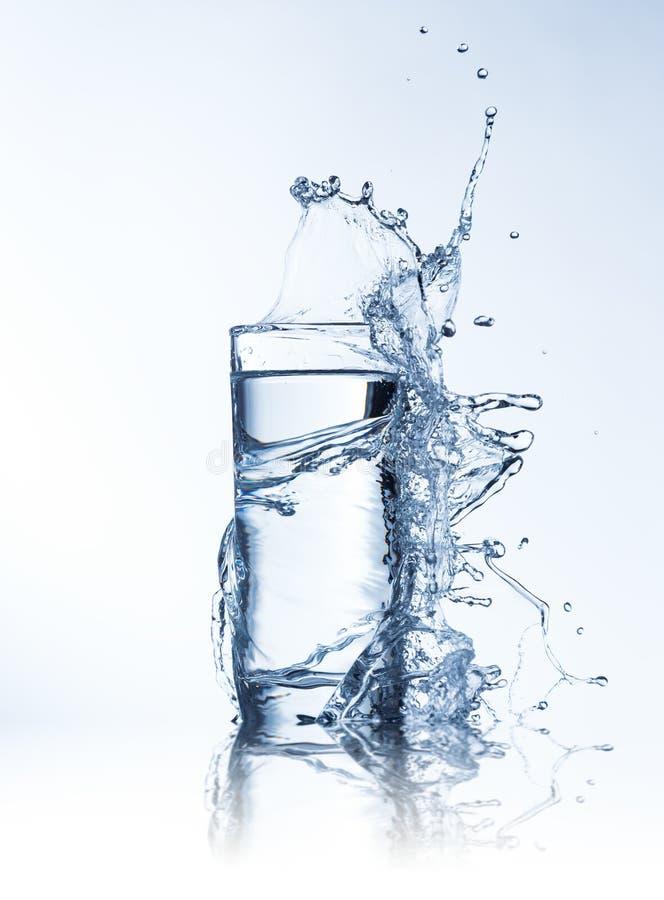 Fresh drink with splashing stream of water. Shot on freeze motion stock photos