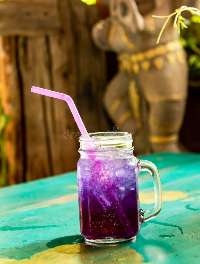 Purple herb lemon soda soft drinks in the afternoon. Fresh drinks, purple herb with lemon soda soft drinks in the afternoon royalty free stock images