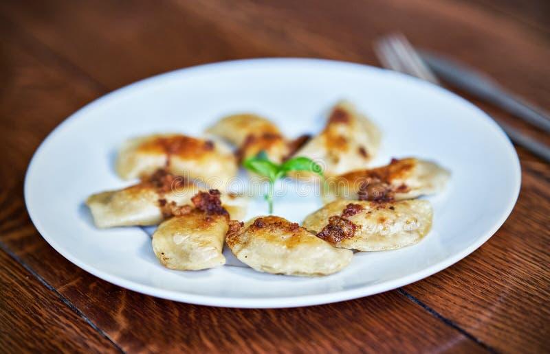 Fresh dumplings served on white plate stock photos