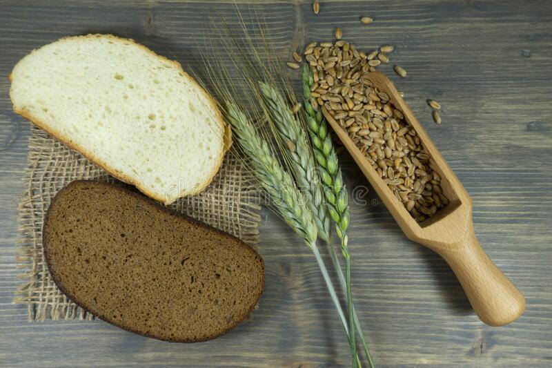 Fresh ears and grains of wheat with bread stock photo