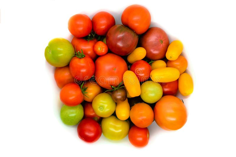 Fresh, ecological and colorful different type tomato isolated on royalty free stock photo