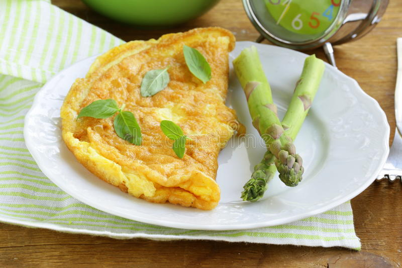 Fresh egg omelet with asparagus royalty free stock photo