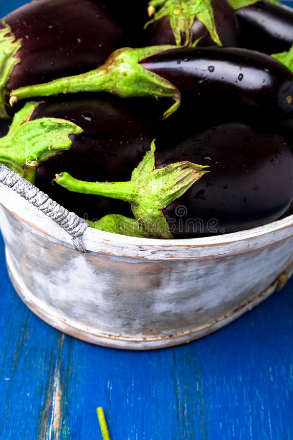 Download Fresh Eggplant In Grey Basket On Blue Wooden Table.Rustic  Background. Close Up