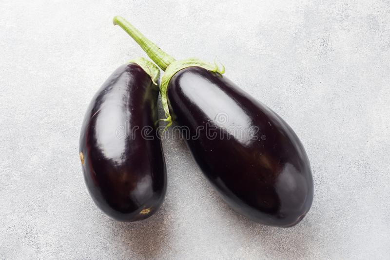 Fresh eggplant on grey concrete background with copy space.  stock photography