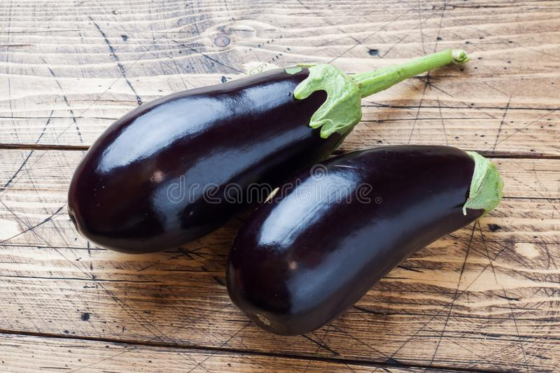 Fresh eggplant on wooden background with copy space.  stock photo