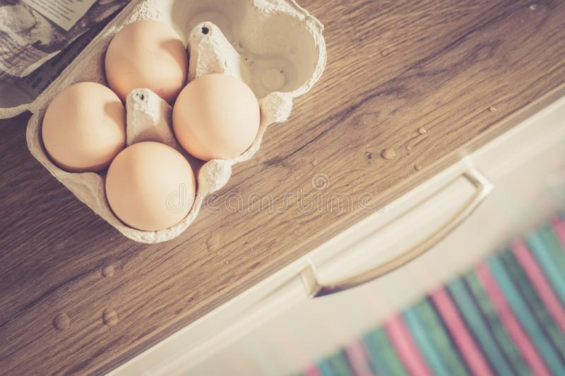 Fresh eggs in the morning: Cardbox of free range eggs in the kitchen royalty free stock photography