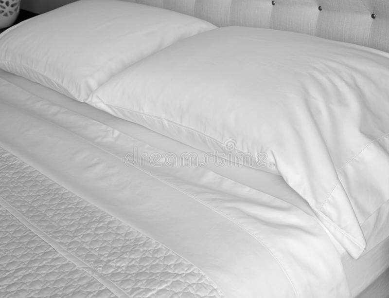 Fresh Egyptian Cotton Bed Linens. Good housekeeping reduces the possibility of dust mites or bed bug infestations in the home and hospitality industry. A royalty free stock photo