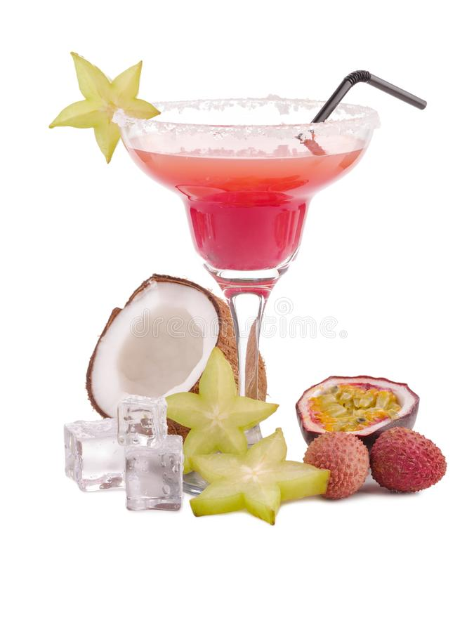 Fresh exotic alcoholic cocktail drink. Tropical fruit flat lay. Ice cubes. Pink coctail royalty free stock photography