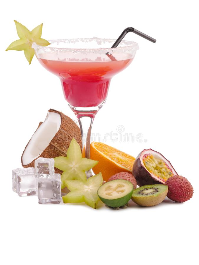 Fresh exotic alcoholic cocktail drink. Tropical fruit flat lay. Ice cubes. Pink coctail royalty free stock image