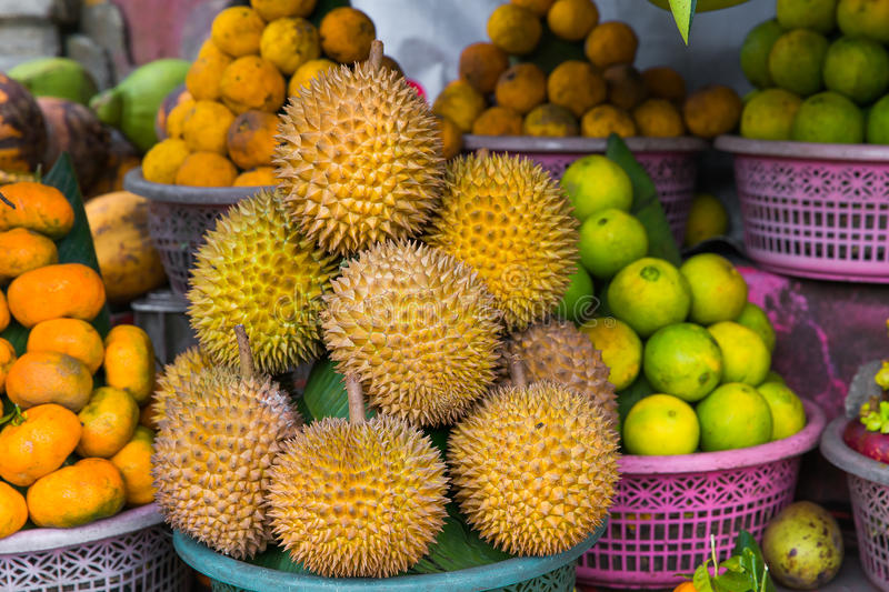 Fresh exotic tropical fruits for sale at an outdoor market. Duri royalty free stock photo