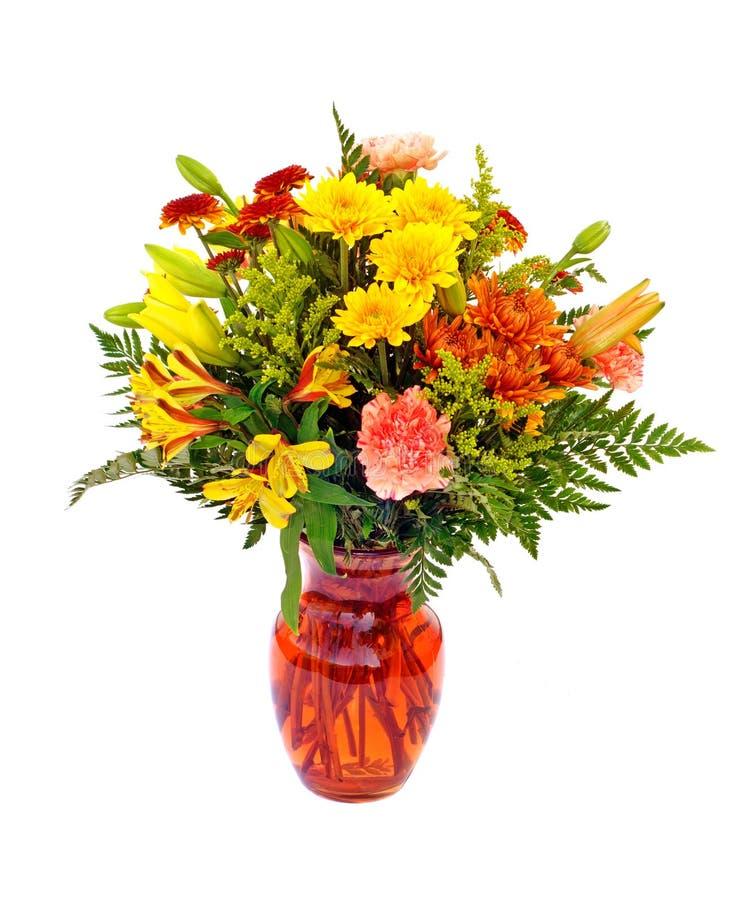 Fresh fall color flower arrangement in orange vase royalty free stock image