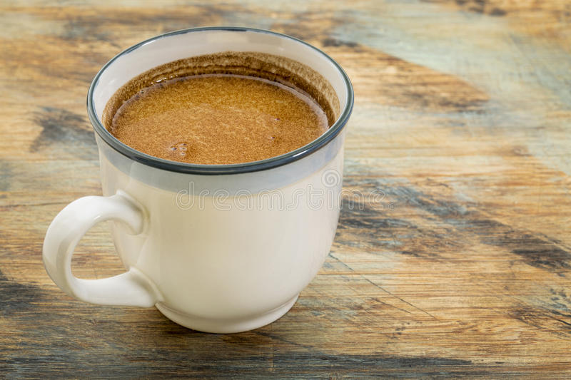 Fresh fatty coffee. A cup of fresh fatty coffee with butter and coconut oil - ketogenic diet concept royalty free stock photography