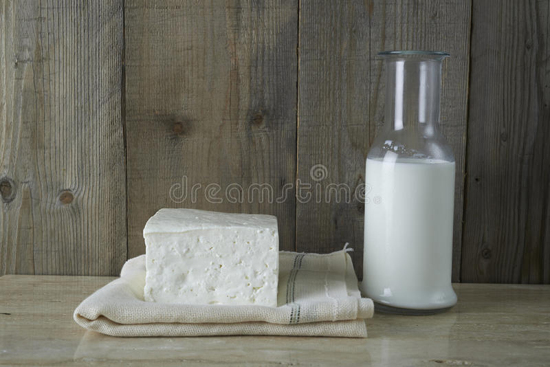 Fresh feta cheese with bottle of milk stock photography