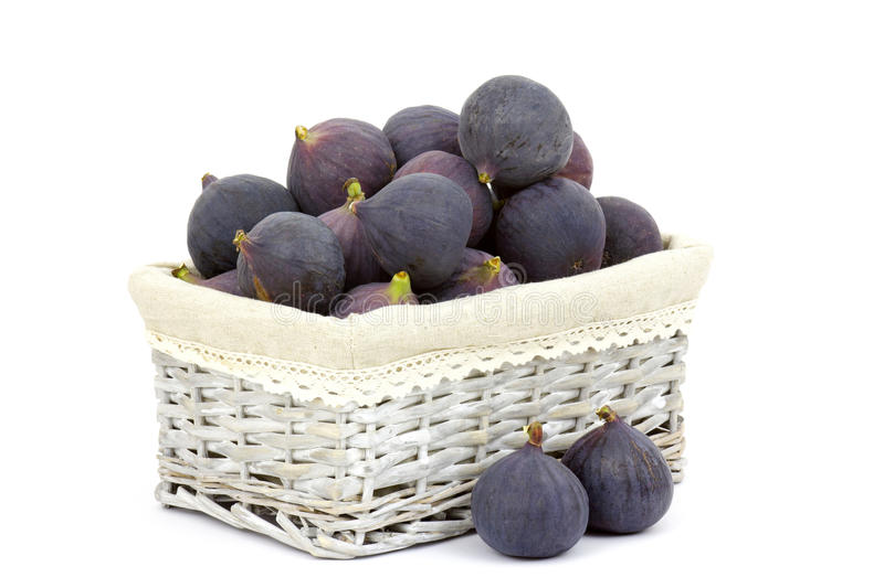 Fresh figs in a basket royalty free stock photos