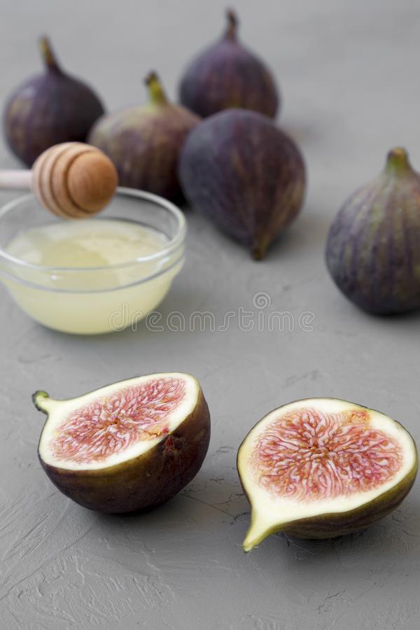 Fresh figs on concrete background, side view. Close-up royalty free stock images