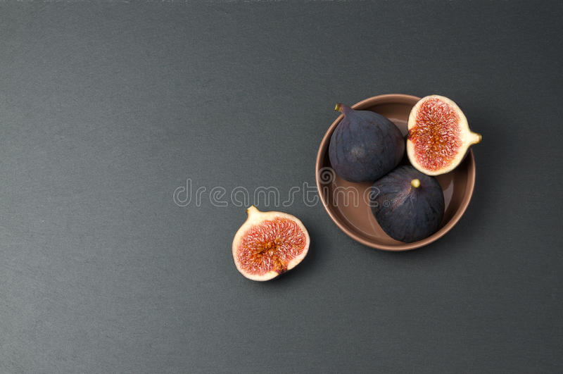 Fresh figs on dark slate background, top view stock image