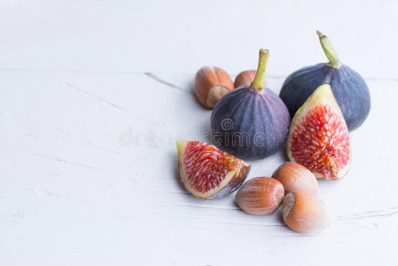 Fresh figs and hazelnut. Vegetarian Food. stock image
