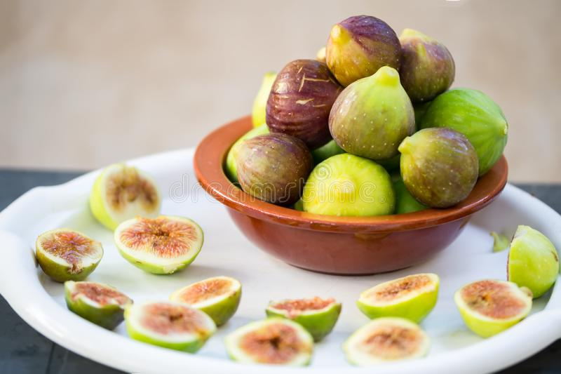 Fresh figsfresh figs in the clay bowl close-up, Apulia, mediterranean fruit stock photos