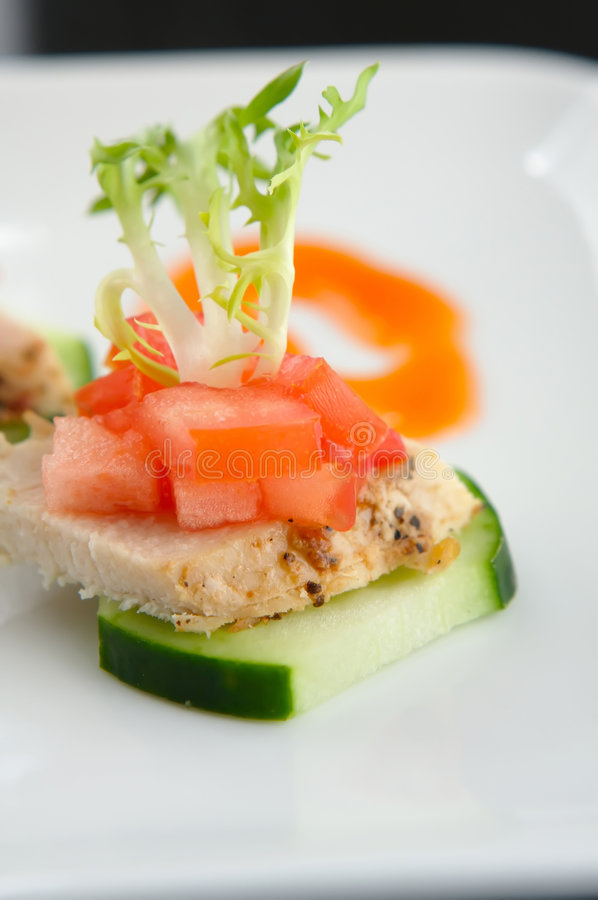 Fresh finger food of Chicken and cucumber. Lite Hors d'oeuvre of Chicken and cucumber royalty free stock photo