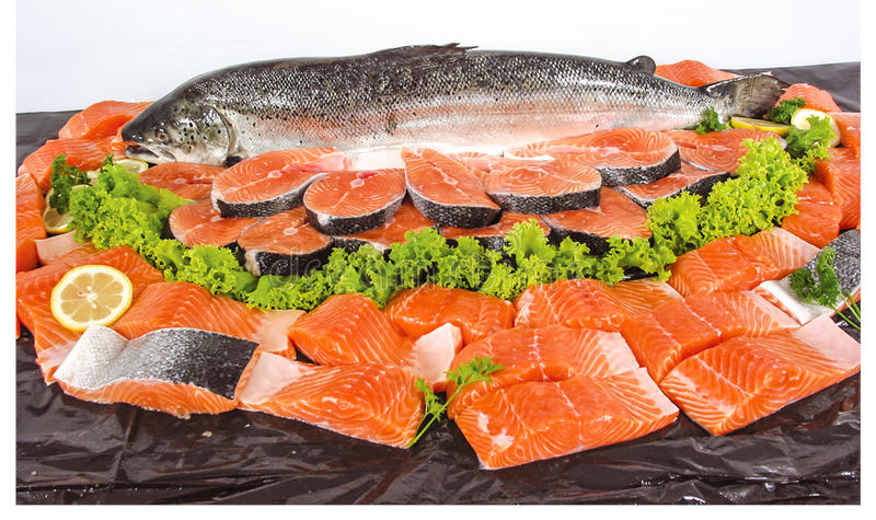 Fresh fish and cut pieces. Fresh fish cut into pieces stock photos