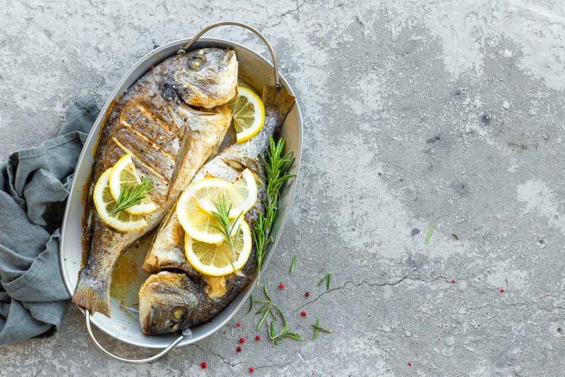 Fresh fish dorado. Raw dorado fish with lemon and rosemary. Sea bream or dorada fish. Stock photo royalty free stock images