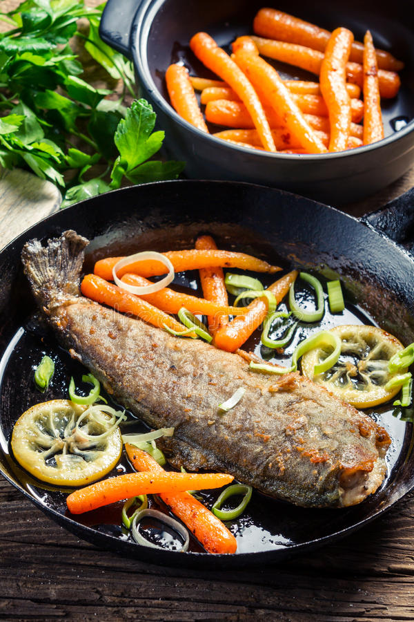 Fresh fish fried in a pan stock photography