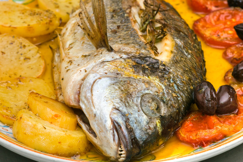 Fresh fish, Gilt-head Bream, cooked in owen stock photography