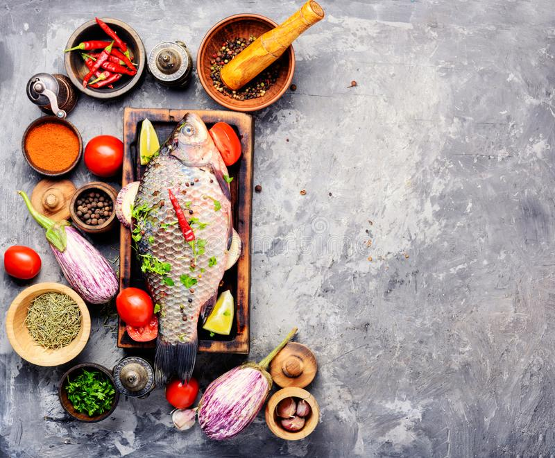 Fresh raw fish and food ingredients royalty free stock photography