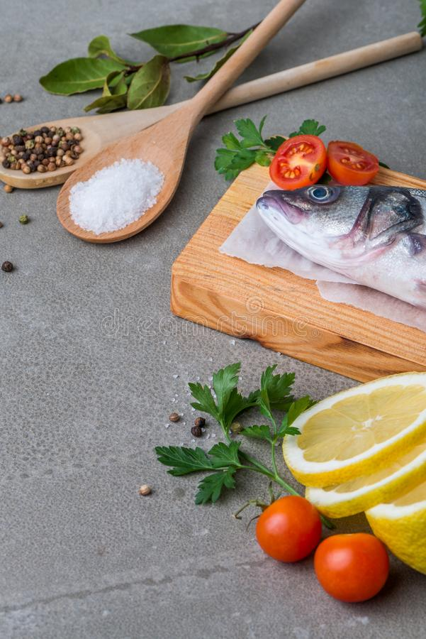 Fresh fish sea bass. On wooden table stock photos