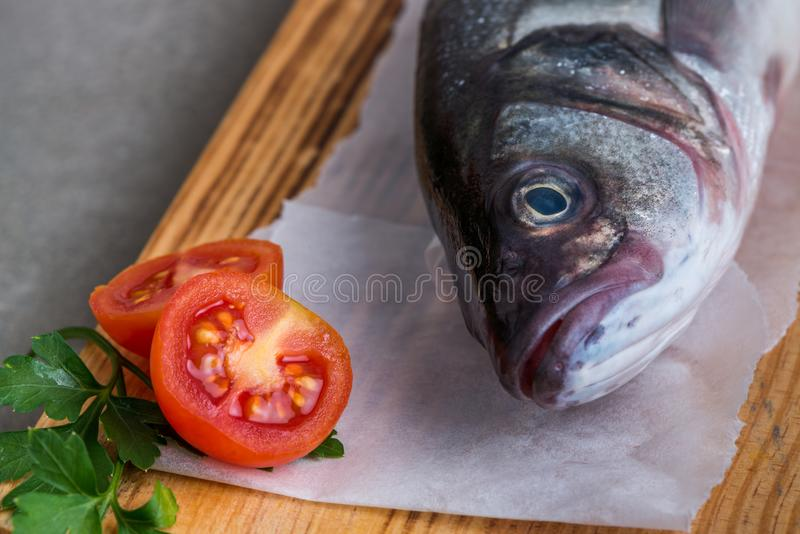 Fresh fish sea bass. On wooden table royalty free stock photography