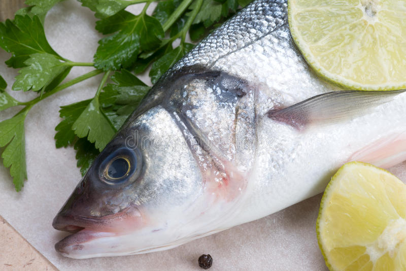 Fresh fish - sea bass. Pepper and lime stock image