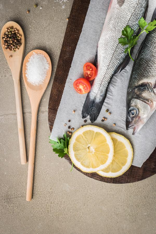 Fresh fish sea bass on wooden table.  royalty free stock image