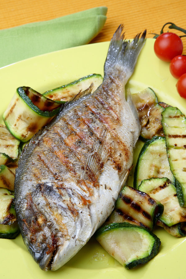 Fresh fish with vegetable stock image