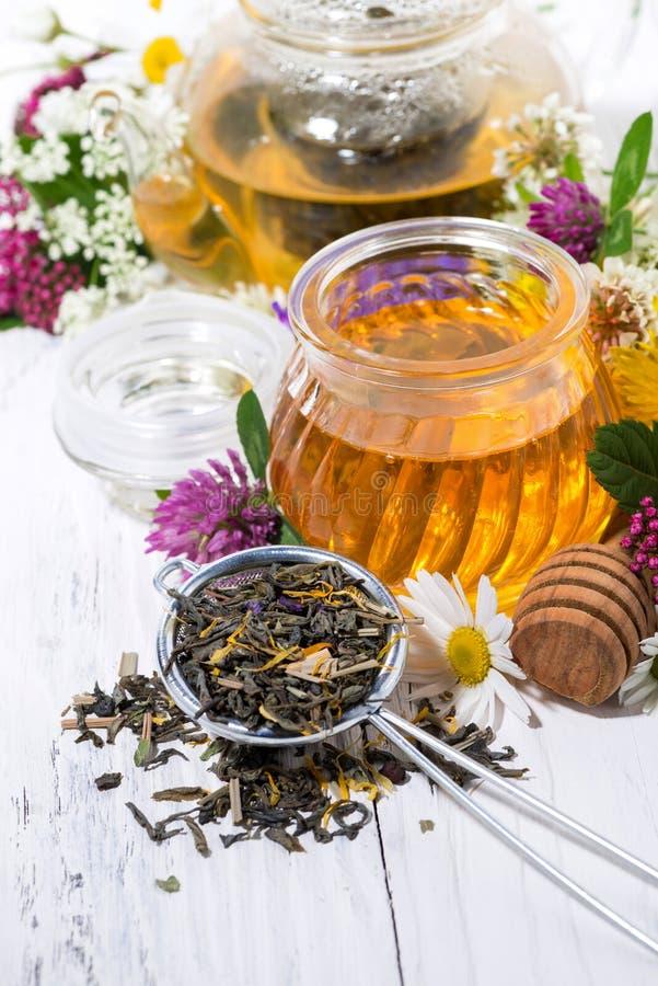 fresh flower honey, tea and ingredients royalty free stock image