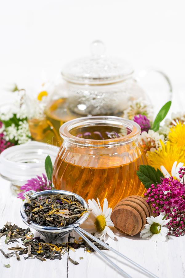 Fresh flower honey, tea and ingredients, vertical. Closeup royalty free stock images