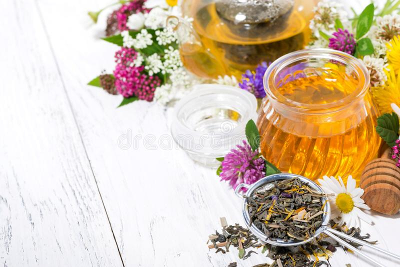 Fresh flower honey, tea and ingredients on white background, top view. Horizontal royalty free stock photography