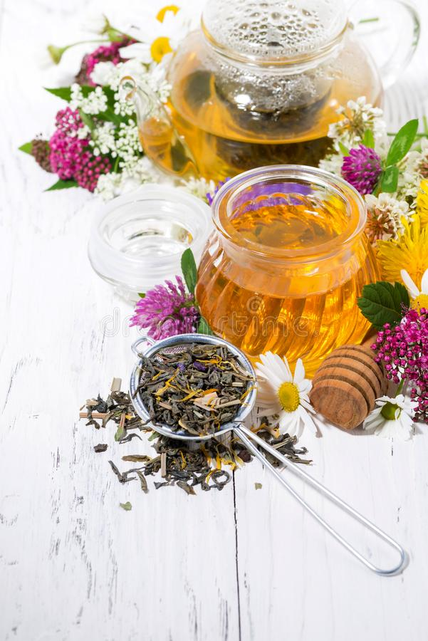 Fresh flower honey, tea and ingredients on white background, vertical. Top view royalty free stock image